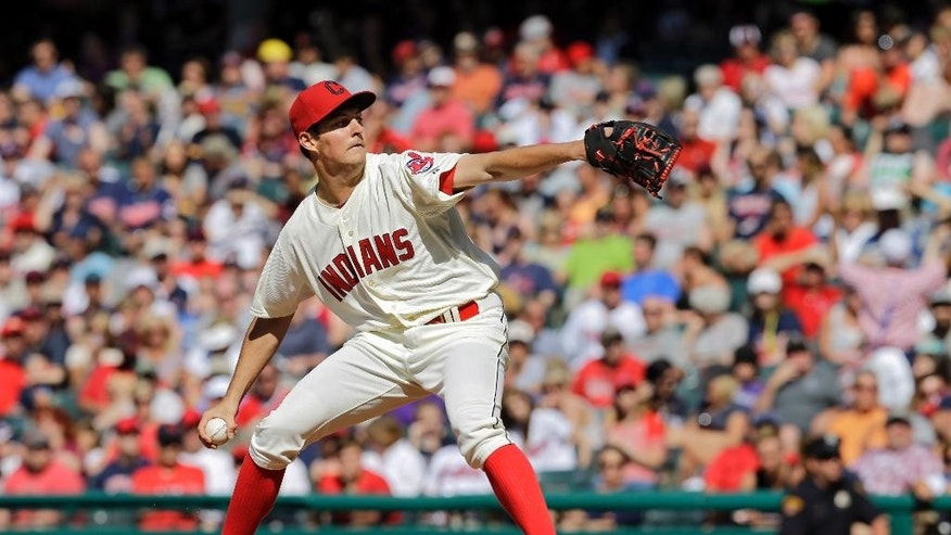 Cleveland Indians starting pitcher Trevor Bauer delivers against the Colorado Rockies in the fifth inning of a baseball game Saturday, May 31, 2014, in Cleveland. (AP Photo/Mark Duncan)