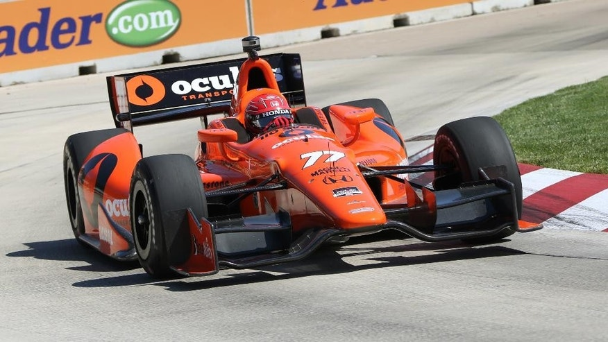 Simon Pgenaud takes a turn during a practice session for the IndyCar Detroit Grand Prix auto race on Belle Isle in Detroit, Friday, May 30, 2014. (AP Photo/Bob Brodbeck)