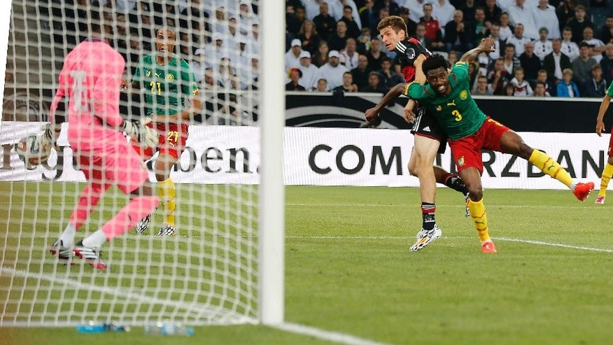 Germany's Thomas Mueller, second from right, scores during a friendly WCup preparation soccer match between Germany and Cameroon in Moenchengladbach, Germany, Monday, June 2, 2014. (AP Photo/Frank Augstein)