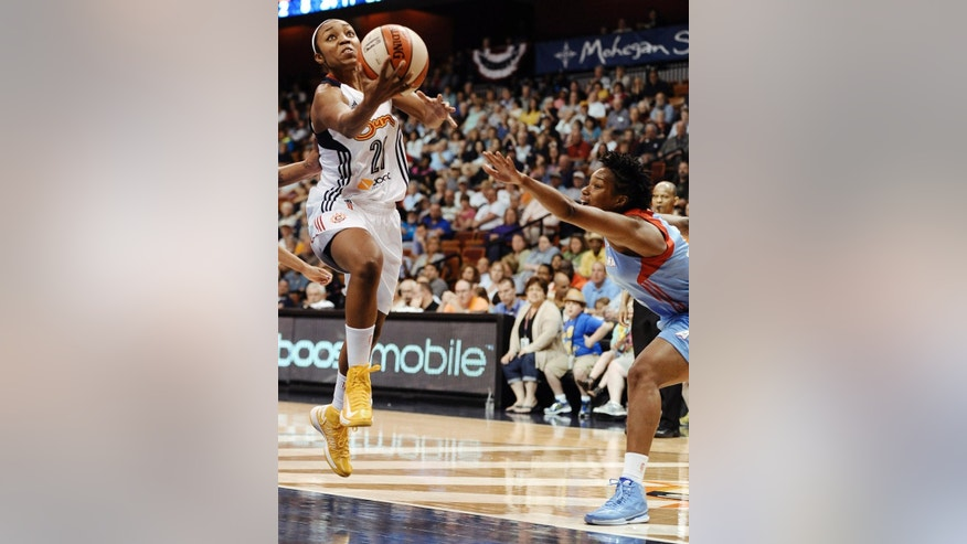 Connecticut's Renee Montgomery, left, goes up for a basket as Atlanta's Amanda Thompson, right, defends during the second half of a WNBA basketball game, Sunday, June 1, 2014, in Uncasville, Conn. The Sun defeated the Dream 85-76. (AP Photo/Jessica Hill)