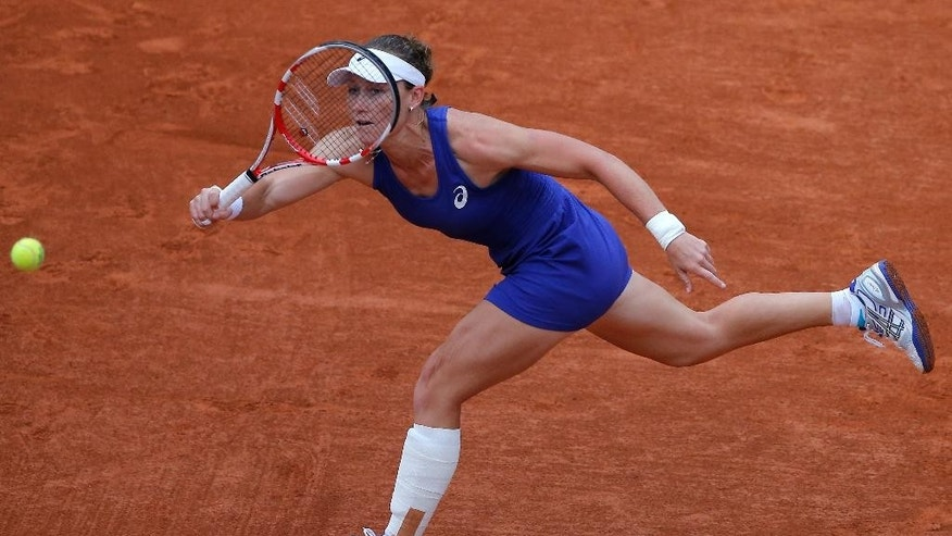 Australia's Samantha Stosur returns the ball Russia's Maria Sharapova during their fourth round match of  the French Open tennis tournament at the Roland Garros stadium, in Paris, France, Sunday, June 1, 2014. (AP Photo/Michel Spingler)
