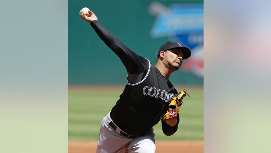 Colorado Rockies starting pitcher Jhoulys Chacin delivers in the first inning of a baseball game against the Cleveland Indians, Sunday, June 1, 2014, in Cleveland. (AP Photo/Tony Dejak)