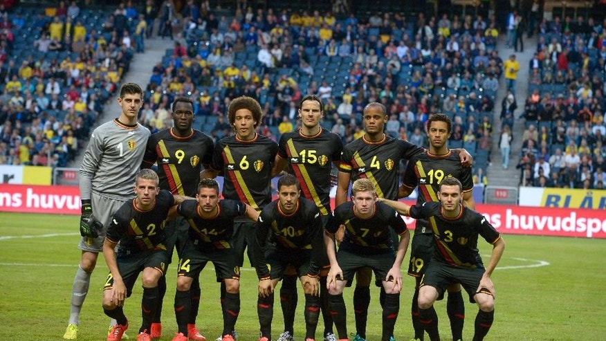 Belgium's national team line-up prior to the friendly soccer match between Sweden and Belgium at Friends Arena, Stockholm, Sweden, Sunday June 1, 2014. Back row from left: Thibaut Courtois, Romelu Lukaku, Axel Witsel, Daniel Van Buyten, Vincent Kompany, Moussa Dembele. Front row: Toby Alderweireid, Dries Mertens, Eden Hazard, Kevin De Bruyne, Thomas Vermaelen. (AP photo / TT News Agency, Janerik Henriksson)   SWEDEN OUT