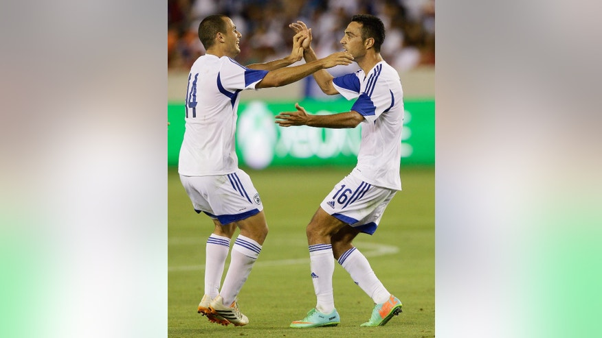 Israel's Eran Zahavi, right, is congratulated by  Neftali Vermouth Gil (14) after he scored against Honduras in the first half during a soccer match Sunday, June 1, 2014, in Houston. (AP Photo/Bob Levey)