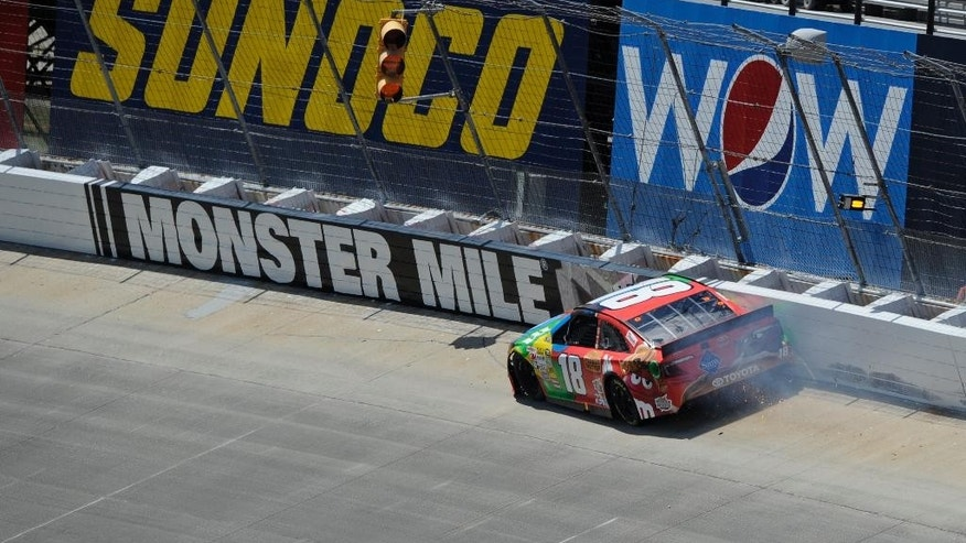 Kyle Busch wrecks along the wall during the NASCAR Sprint Cup Series auto race, Sunday, June 1, 2014, at Dover International Speedway in Dover, Del. (AP Photo/Nick Wass)
