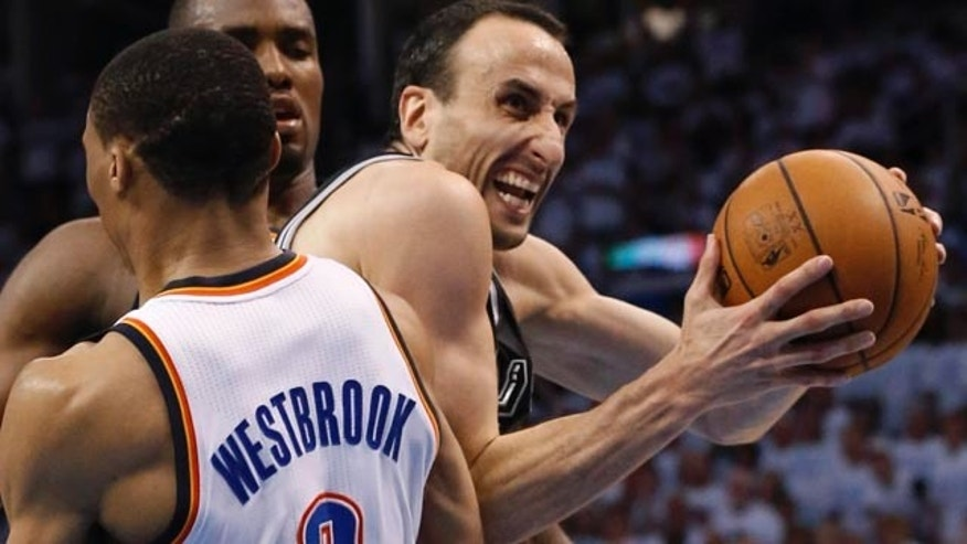 May 31, 2014: San Antonio Spurs guard Manu Ginobili is caught between Oklahoma City Thunder's Russell Westbrook (back to camera) and Serge Ibaka in the second half of Game 6 of the NBA Western Conference Finals in Oklahoma City. (AP Photo/Sue Ogrocki)