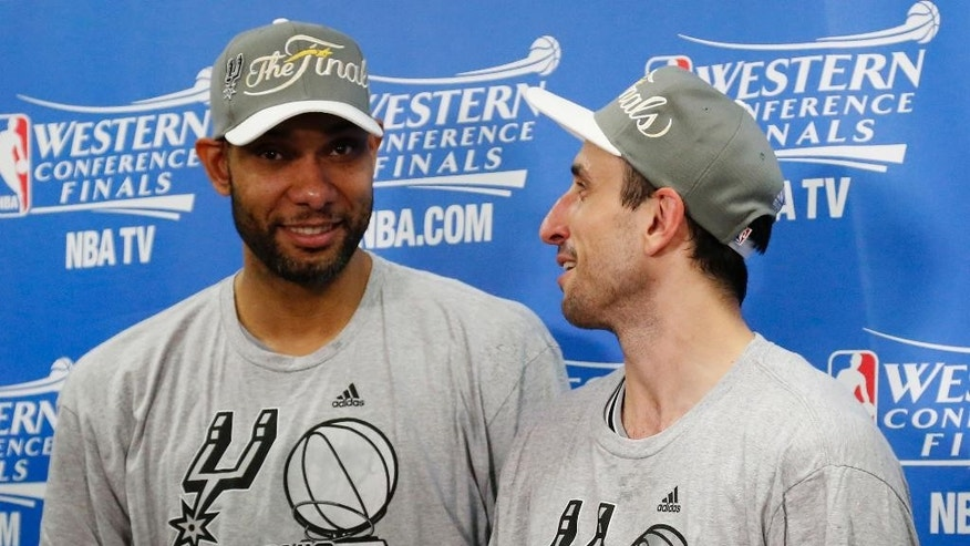 San Antonio Spurs' Tim Duncan, left and Manu Ginobili talk following Game 6 of the Western Conference finals NBA basketball playoff series against the Oklahoma City Thunder in Oklahoma City, Saturday, May 31, 2014. San Antonio won 112-107, and advanced to the NBA Finals. (AP Photo/Sue Ogrocki, Pool)