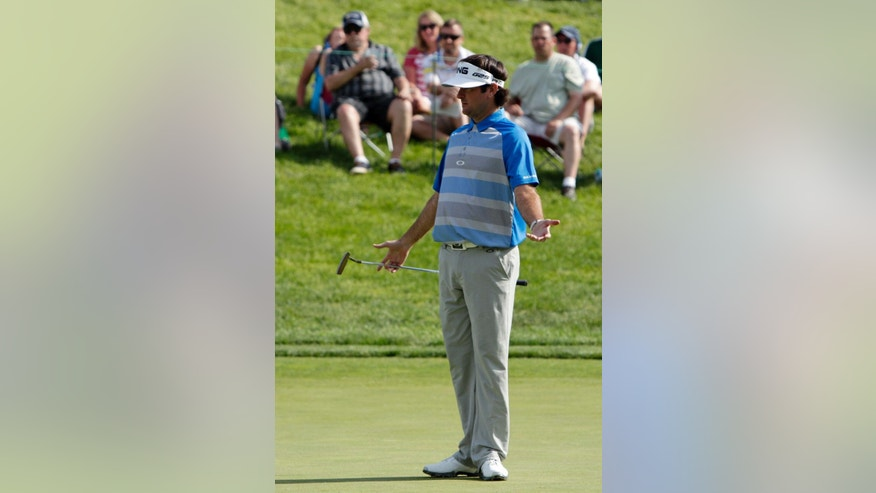 Bubba Watson reacts to a putt on the 15th green during the final round of the Memorial golf tournament Sunday, June 1, 2014, in Dublin, Ohio. (AP Photo/Jay LaPrete)