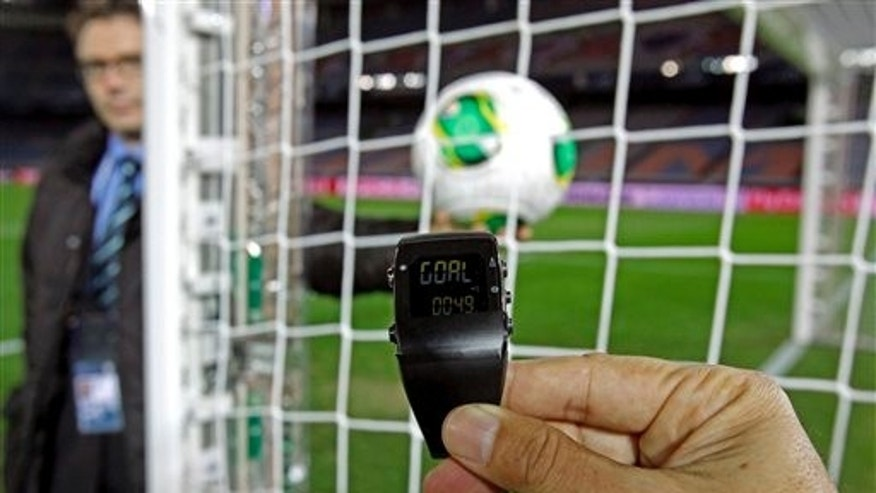 FILE - In this Wednesday, Dec. 5, 2012, file photo, the goal-line monitoring device is demonstrated before the media at Yokohama Stadium in Yokohama, near Tokyo. For the first time at a World Cup, technology will be used to determine whether a ball crosses the goal line during matches at the upcoming tournament in Brazil. With vanishing spray also being used to prevent encroachment by defenders making up a wall during free kicks, officials at the highest level of the worlds most popular sport are finally getting some assistance. (AP Photo/Shuji Kajiyama, File)