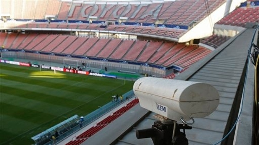 FILE - In this Saturday, Dec. 8, 2012, file photo, a Hawk-Eye camera is set up at Toyota stadium in Toyota. For the first time at a World Cup, technology will be used to determine whether a ball crosses the goal line during matches at the upcoming tournament in Brazil. With vanishing spray also being used to prevent encroachment by defenders making up a wall during free kicks, officials at the highest level of the worlds most popular sport are finally getting some assistance. (AP Photo/Shuji Kajiyama)