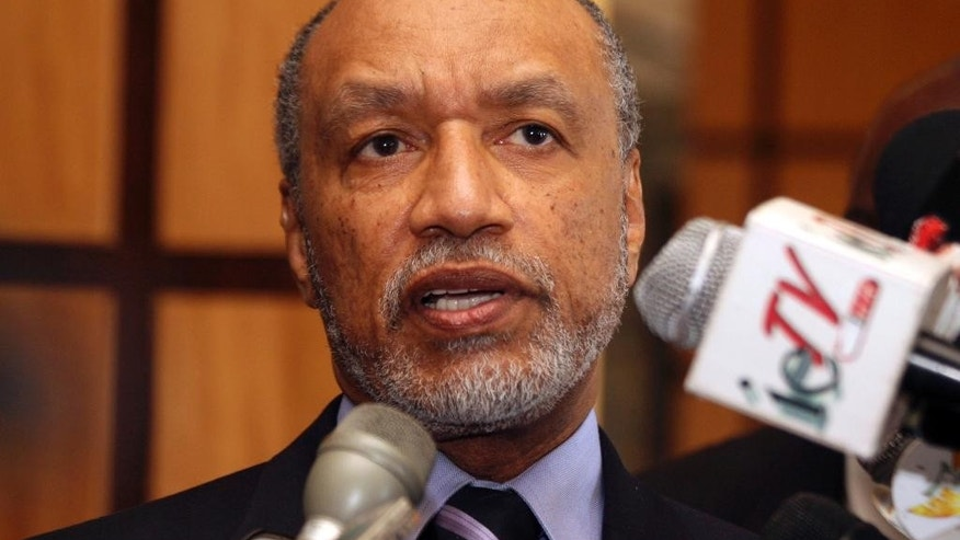 "FILE - In this May 10, 2011 file picture of Mohamed bin Hammam, chief of the Asian Football Confederation, as he talks to local media in Port of Spain, Trinidad & Tobago. Organizers of the 2022 World Cup in Qatar on Sunday June 1, 2014 denied fresh allegations of wrongdoing after a British newspaper report questioned the integrity of choosing the emirate as tournament host. The Sunday Times said a ""senior FIFA insider"" had provided ""hundreds of millions of emails, accounts and other documents"" detailing payments totaling $5 million that Qatari official Mohamed bin Hammam allegedly gave football officials to build support for the bid. (AP Photo/Shirley Bahadur, File)"