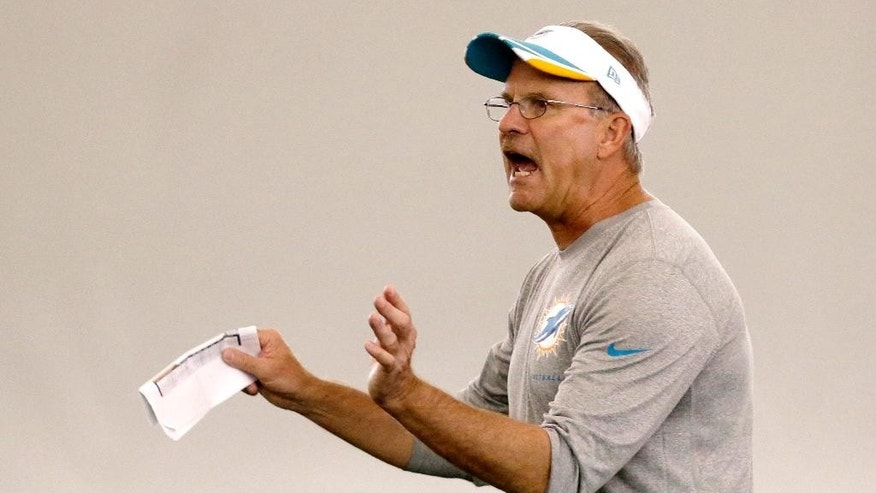 Miami Dolphins defensive coordinator Kevin Coyle calls out a play during an NFL organized team activities football practice, Monday, June 2, 2014 at the Dolphins Training Facility in Davie, Fla. (AP Photo/Wilfredo Lee)