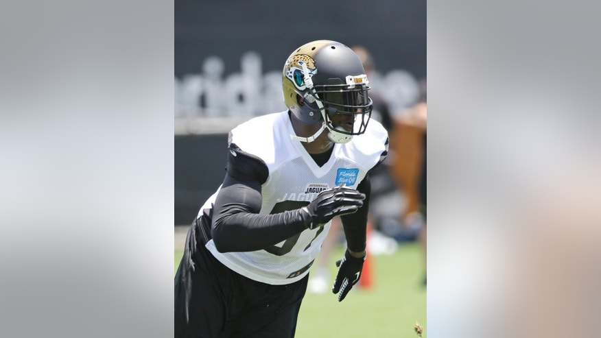 Jacksonville Jaguars defensive end Chris Clemons, runs through a drill during an NFL organized team activities football practice in  in Jacksonville, Fla., Monday, June 2, 2014. (AP Photo/John Raoux)