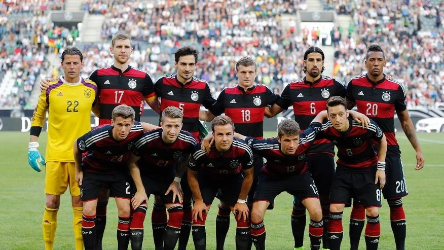 Team Germany poses for a group photo prior  a friendly WCup preparation soccer match between Germany and Cameroon in Moenchengladbach, Germany, Monday, June 2, 2014. (AP Photo/Frank Augstein)