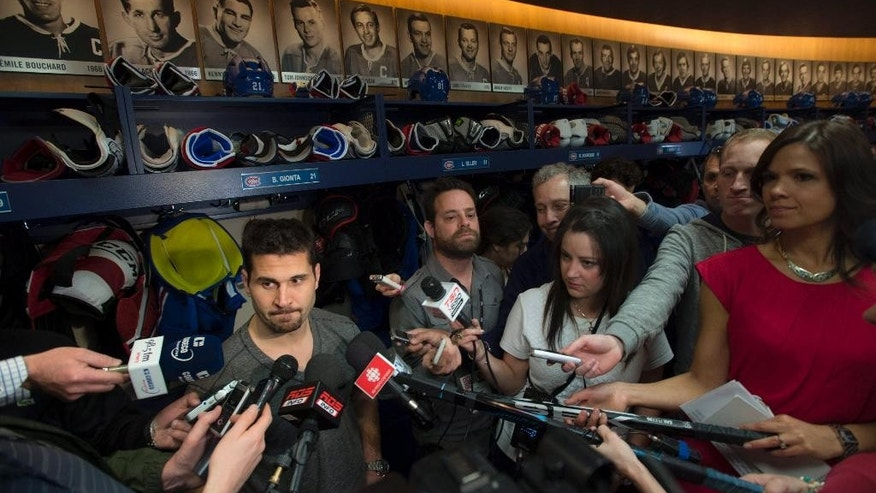Montreal Canadiens captain Brian Gionta talks with reporters at the team's training facility Saturday, May 31, 2014 in Brossard, Quebec. The Canadiens were eliminated from the NHL hockey Stanley Cup playoffs by the New York Rangers in Game 6 of the Eastern Conference final on Thursday, May 29. (AP Photo/The Canadian Press, Paul Chiasson)