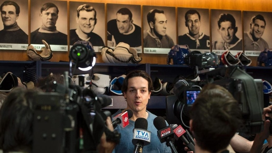 Montreal Canadiens' Daniel Briere talks with reporters at the team's training facility Saturday, May 31, 2014 in Brossard, Quebec. The Canadiens were eliminated from the NHL hockey Stanley Cup playoffs by the New York Rangers in Game 6 of the Eastern Conference final on Thursday, May 29. (AP Photo/The Canadian Press, Paul Chiasson)