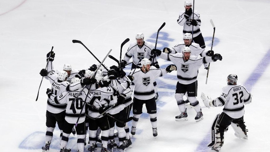 Los Angeles Kings celebrate after defeating Chicago Blackhawks 5-2 in the overtime period in Game 7 of the Western Conference finals in the NHL hockey Stanley Cup playoffs Sunday, June 1, 2014, in Chicago. (AP Photo/Charles Rex Arbogast)