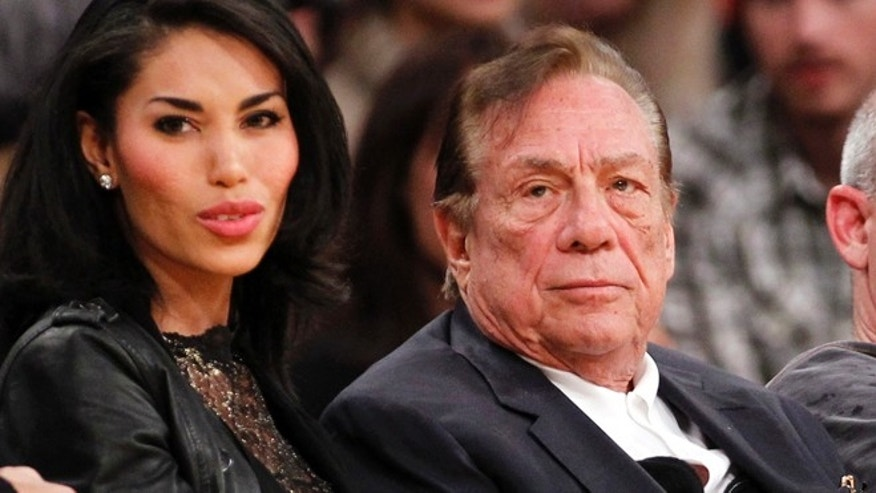 Dec. 19, 2010: Los Angeles Clippers owner Donald Sterling, right, sits with V. Stiviano, left, as  they watch the Clippers play the Los Angeles Lakers during an NBA preseason basketball game in Los Angeles.