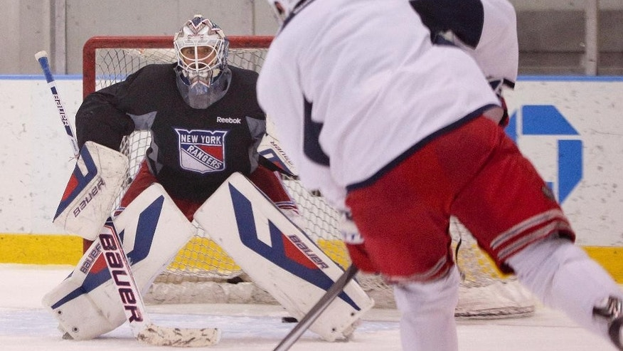 New York Rangers goalie Henrik Lundqvist looks to block a shot by center Brad Richards (19) during practice, Monday, June 2, 2014, in Greenburgh, N.Y. The Rangers will face the Los Angeles Kings in Game 1 of Stanley Cup Final in Los Angeles on Wednesday. (AP Photo/Julie Jacobson)
