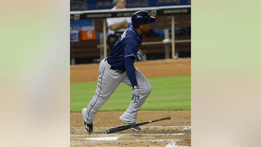 Tampa Bay Rays' Desmond Jennings heads to first base after hitting a double against the Miami Marlins in the fifth inning of an interleague  baseball game in Miami, Monday, June 2, 2014. Sean Rodriguez scored on the double. (AP Photo/Alan Diaz)