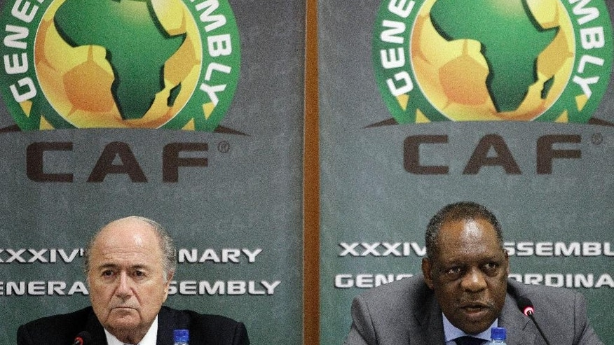 "FILE - This is a Friday Feb. 10, 2012 file photo of  Confederation of African Football President Issa Hayatou, right, speaks as FIFA President Sepp Blatter, left, looks on during a joint press conference in Libreville, Gabon. FIFA vice president and African football head Issa Hayatou  denied allegations Sunday June 1, 2014  made against him by British newspaper The Sunday Times that he received favors for voting for Qatar to host the 2022 World Cup.  In a statement late Sunday night, the Confederation of African Football called the corruption allegations against its president ""fanciful"" and ""ridiculous.""  (AP Photo/Themba Hadebe, File)"