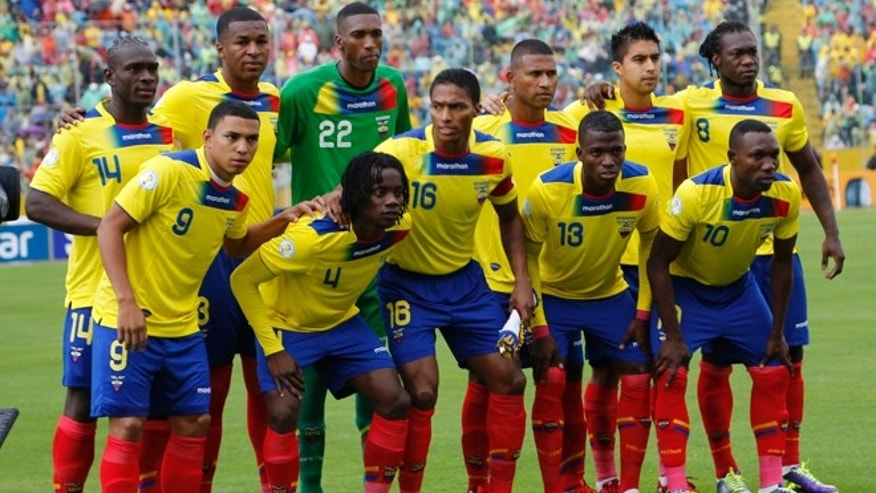 FILE - In this Oct. 11, 2013 file photo, Ecuador national team poses prior to the start the 2014 World Cup qualifying soccer match between Ecuador and Uruguay in Quito, Ecuador. Foreground from left: Jefferson Montero, Juan Carlos Paredes, Antonio Valencia, Enner Valencia and Walter Ayovi. Background from left: Segundo Castillo, Frickson Erazo, Alexander Dominguez, Jorge Guagua, Cristhian Noboa, and Felipe Caicedo. (AP Photo/Dolores Ochoa, File)