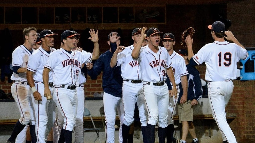 Virginia's Nathan Kirby, right, is congratulated by teammates after coming off the field during the eighth inning of an NCAA college baseball regional tournament game against Arkansas in Charlottesville, Va., Saturday, May 31, 2014. Kirby gave up only one hit in eight innings of work. (AP Photo/Pat Jarrett)