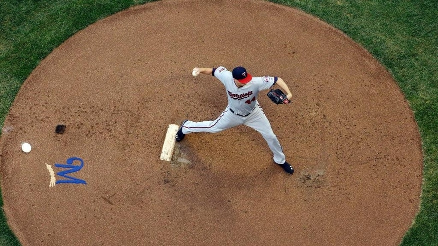 Minnesota Twins starting pitcher Kyle Gibson throws during the first inning of a baseball game against the Milwaukee Brewers Monday, June 2, 2014, in Milwaukee. (AP Photo/Morry Gash)