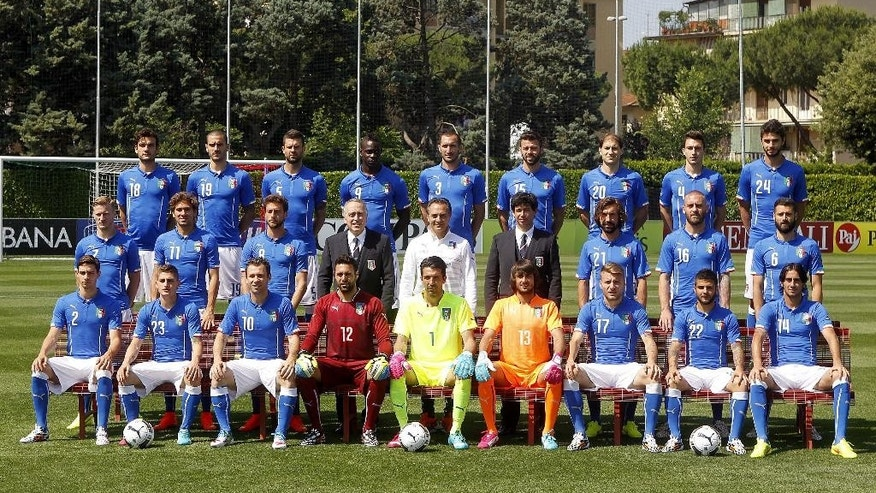 ADDS THE NAMES OF THE PLAYERS AND OFFICIALS Italian national soccer team pose with the official team jersey, at the Coverciano center, near Florence, Italy, Tuesday, June 3, 2014. Front row, from left, sitting, Mattia De Sciglio, Marco Verratti, Antonio Cassano, Salvatore Sirigu, Gianluigi Buffon, Mattia Perin, Ciro Immobile, Lorenzo Insigne and Alberto Aquilani. Center row, from left, Ignazio Abate, Alessio Cerci, Claudio Marchisio, president of the Italian soccer federation Giancarlo Abete, coach Cesare Prandelli, vice-president of the Italian Soccer Federation Demetrio Albertini, Andrea Pirlo, Daniele De Rossi and Antonio Candreva. Third row, from left, Marco Parolo, Leonardo Bonucci, Thiago Motta, Mario Balotelli, Giorgio Chiellini, Andrea Barzagli, Gabriel Paletta, Matteo Darmian and Andrea Ranocchia. (AP Photo/Fabrizio Giovannozzi)