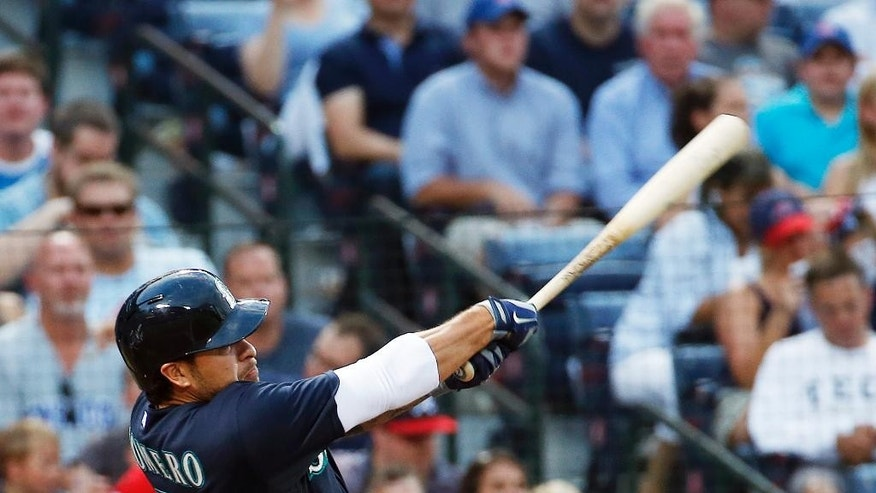 Seattle Mariners' Stefen Romero follows through with a three-run home run in the fourth inning of a baseball game against the Atlanta Braves on Tuesday, June 3, 2014, in Atlanta.  (AP Photo/John Bazemore)