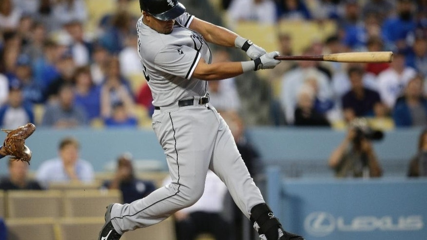 Chicago White Sox's Jose Abreu hits a two-run home run during the fourth inning of a baseball game against the Los Angeles Dodgers on Monday, June 2, 2014, in Los Angeles. (AP Photo/Jae C. Hong)