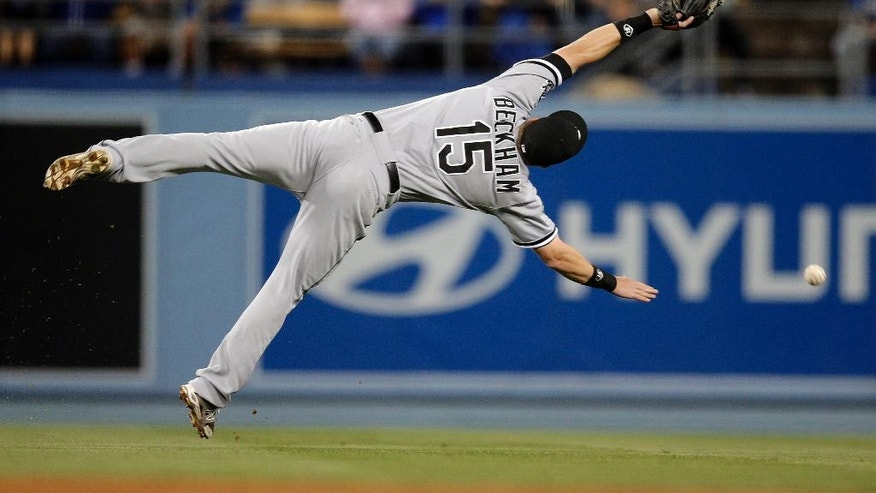 Chicago White Sox second baseman Gordon Beckham can't catch a two-run single hit by Los Angeles Dodgers' Justin Turner during the sixth inning of a baseball game on Monday, June 2, 2014, in Los Angeles. (AP Photo/Jae C. Hong)
