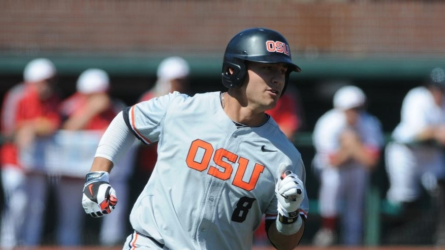 Oregon State's Michael Conforto (8) rounds first base on a hit against UNLV during an NCAA college baseball regional tournament game in Corvallis, Ore., Sunday, June 1, 2014. (AP Photo/Mark Ylen)