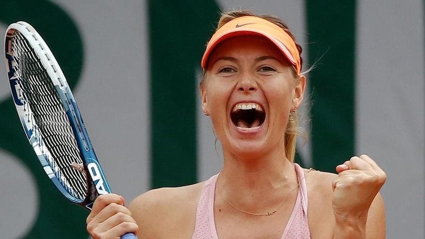 Russia's Maria Sharapova reacts as she defeats Spain's Garbine Muguruza during their quarterfinal match of  the French Open tennis tournament at the Roland Garros stadium, in Paris, France, Tuesday, June 3, 2014. Sharapova won 1-6, 7-5, 6-1. (AP Photo/Michel Euler)