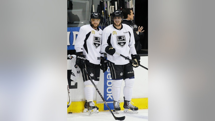 Los Angeles Kings' Marian Gaborik, left, of Slovakia, and Anze Kopitar, of Slovenia, smile as they chat during practice for Wednesday's Game 1 of the NHL Stanley Cup Final hockey series against the New York Rangers on Tuesday, June 3, 2014, in Los Angeles.(AP Photo/Jae C. Hong)