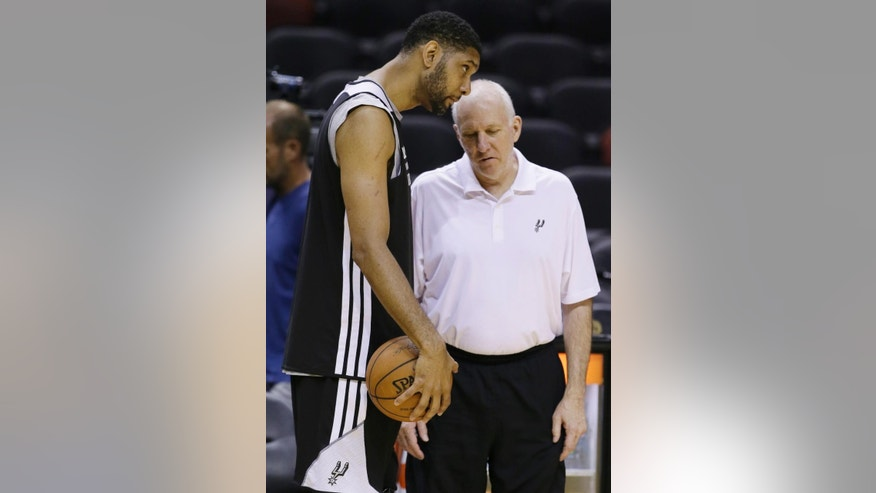 San Antonio Spurs forward Tim Duncan, left and head coach Gregg Popovich talk during basketball practice on Wednesday, June 4, 2014 in San Antonio. The Spurs play Game 1 of the NBA Finals against the Miami Heat on Thursday. (AP Photo/Tony Gutierrez)