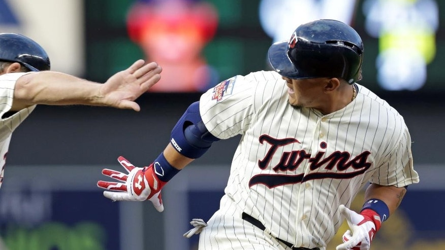Minnesota Twins' Oswaldo Arcia, right, passes third on his three-run home run off Milwaukee Brewers  pitcher Marco Estrada  in the fourth inning of a baseball game, Wednesday, June 4, 2014, in Minneapolis. (AP Photo/Jim Mone)