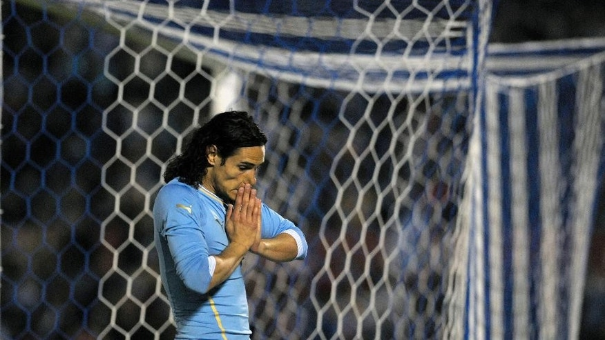 Uruguay's Edinson Cavani gestures during a friendly soccer match against Slovenia in Montevideo, Uruguay, Wednesday, June 4, 2014. (AP Photo/Matilde Campodonico)