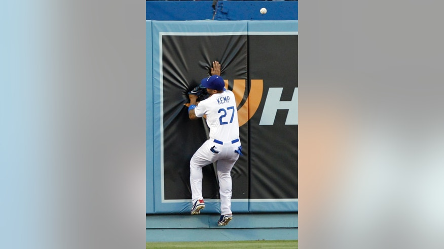 Los Angeles Dodgers left fielder Matt Kemp (27) misses the ball and hits the wall as Chicago White Sox' Gordon Beckham hits a double in the first inning of a baseball game on Tuesday, June 3, 2014 in Los Angeles. (AP Photo/Alex Gallardo)
