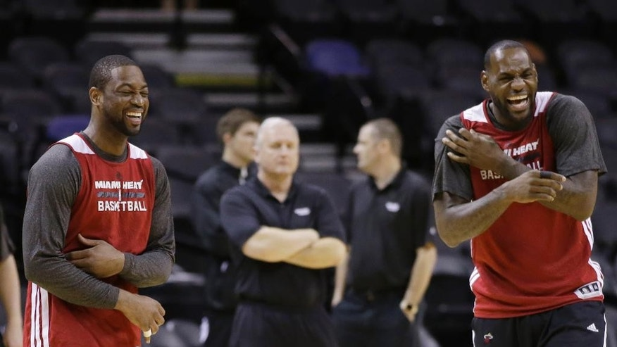 Miami Heat guard Dwyane Wade, left, and forward LeBron James, right, share a laugh basketball practice on Wednesday, June 4, 2014 in San Antonio. They play Game 1 of the NBA Finals against the San Antonio Spurs on Thursday. (AP Photo/Tony Gutierrez)
