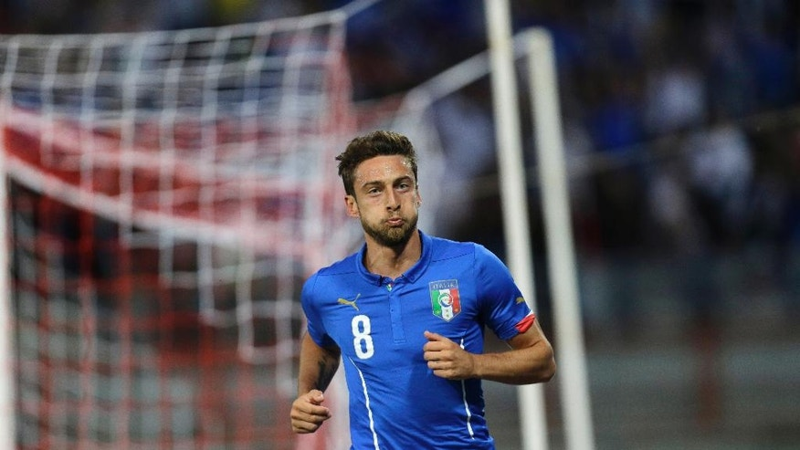 Italy midfielder Claudio Marchisio runs back after scoring during a friendly World Cup preparation soccer match between Italy and Luxembourg in Perugia, Italy, Wednesday, June 4, 2014. Italy opens its Brazilian World Cup campaign against England in Group D on June 14 then faces Costa Rica on June 20 and Uruguay on June 24. (AP Photo/Luca Bruno)