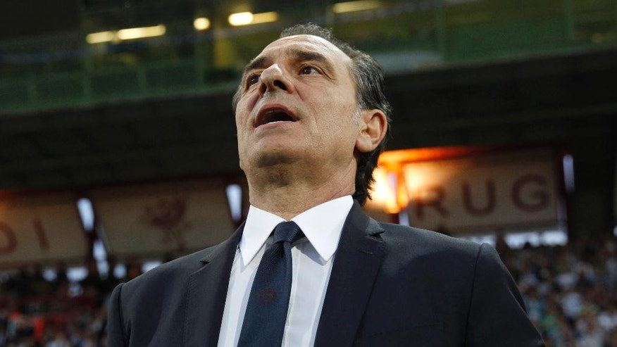 Italy coach Cesare Prandelli sings the national anthem ahead of a friendly World Cup preparation soccer match between Italy and Luxembourg in Perugia, Italy, Wednesday, June 4, 2014. Italy opens its Brazilian World Cup campaign against England in Group D on June 14 then faces Costa Rica on June 20 and Uruguay on June 24. (AP Photo/Luca Bruno)
