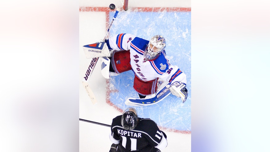 New York Rangers goalie Henrik Lundqvist, of Sweden, top, and Los Angeles Kings center Anze Kopitar, of Slovenia, the watches puck flip up in the during the third period in Game 1 of the NHL hockey Stanley Cup Finals, Wednesday, June 4, 2014, in Los Angeles. (AP Photo/Mark J. Terrill)