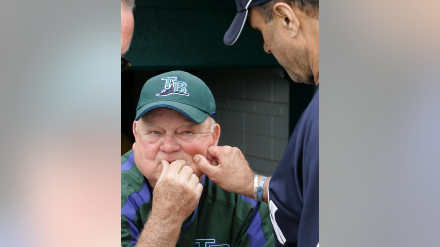 FILE - In this March 2, 2007, file photo, Tampa Bay Devil Rays senior adviser Don Zimmer, left, has his cheek pinched by New York Yankees manager Joe Torre prior to a spring training baseball game in St. Petersburg, Fla. Zimmer, a popular fixture in professional baseball for 66 years as a manager, player, coach and executive, has died. He was 83. Zimmer was still working for the Rays as a senior adviser. The team confirmed Wednesday night, June 4, 2014, that he had died. Zimmer had been in a rehabilitation center in Florida since having heart surgery in mid-April. (AP Photo/Al Behrman, File)