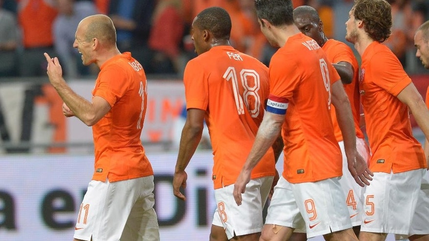 Netherlands player Arjen Robben, left, celebrates scoring against Wales with teammates during their international friendly soccer match at ArenA stadium in Amsterdam, Netherlands, Wednesday June 4, 2014. (AP photo/Ermindo Armino)