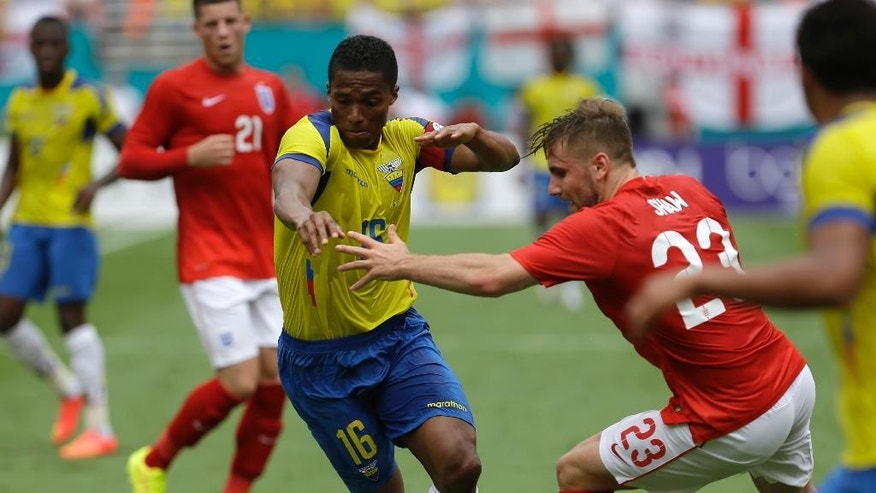 Ecuador's Luis Antonio Valencia (16) drives as England's Luke Shaw (23) defends in the first half of a friendly soccer match in Miami Gardens, Fla., Wednesday, June 4, 2014. (AP Photo/Alan Diaz)