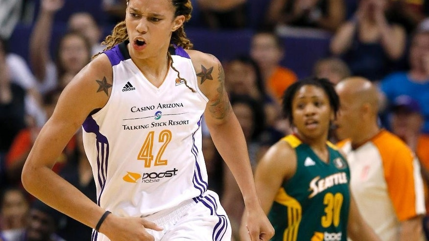Phoenix Mercury's Brittney Griner (42) shouts in celebration after scoring as Seattle Storm's Tanisha Wright (30) looks on during the first half of a WNBA basketball game on Tuesday, June 3, 2014, in Phoenix. (AP Photo/Ross D. Franklin)