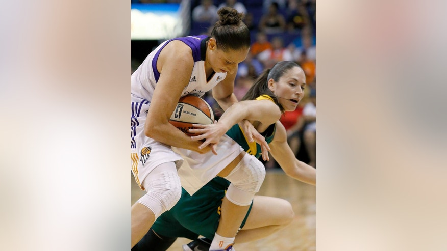 Phoenix Mercury's Diana Taurasi, left, steals the ball from Seattle Storm's Sue Bird during the first half of a WNBA basketball game on Tuesday, June 3, 2014, in Phoenix. (AP Photo/Ross D. Franklin)