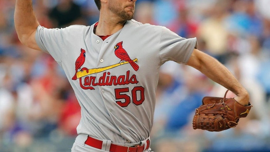 St. Louis Cardinals starting pitcher Adam Wainwright delivers to a Kansas City Royals batter during the first inning of a baseball game at Kauffman Stadium in Kansas City, Mo., Wednesday, June 4, 2014. (AP Photo/Orlin Wagner)