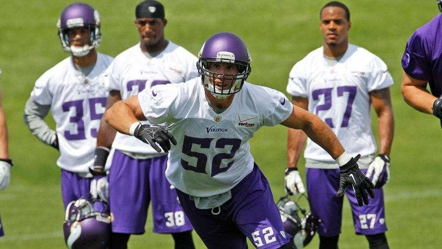 Minnesota Vikings outside linebacker Chad Greenway (52) takes part in a drill during an NFL organized team activity in Eden Prairie, Minn., Thursday, June 5, 2014.   (AP Photo/Ann Heisenfelt)